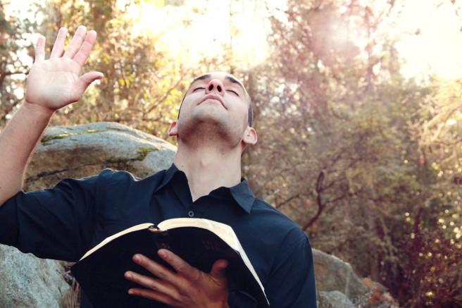 man-in-worship-christian-stock-photo